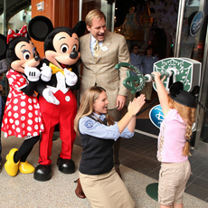 Minnie, Mickey, President of Disney Store Worldwide Jim Fielding, Santa Monica Store Manager Diane Derudder, and a young Guest